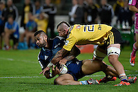 Blade Thomson ( Hurricanes ) and  Frank Halai ( Blues ) in action during the Super Rugby - Hurricanes v Blues at FMG Stadium, Palmerston North, New Zealand on Friday 13 March 2015. <br /> Photo by Masanori Udagawa. <br /> www.photowellington.photoshelter.com.