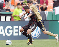 Andy Najar #14 of D.C. United battles for the ball with Nick Zimmerman #23 of the Philadelphia Union during an MLS match at RFK Stadium on August 22 2010, in Washington DC. United won 2-0.