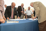 Lease signing for Mifflin Township Fire Department's new Mech Center.