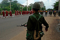 The army managed to hem this demonstation into a road with no getaway exits. They fired machine gun fire over the protesters' heads, and then 'convinced' the monks to move out in a narrow file. The members of the public in the demonstration were arrested. Protests led by Buddhist monks calling for the overthrow of the country's military junta had continued despite a new threat that the military would shoot on sight any gatherings of over four people.