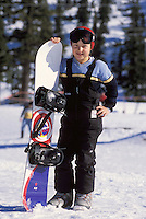 Little girl posing with snowboard, Mt. Baker, Cascade Range, Washingto