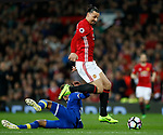 Zlatan Ibrahimovic of Manchester United skips past Mason Holgate of Everton during the English Premier League match at Old Trafford Stadium, Manchester. Picture date: April 4th 2017. Pic credit should read: Simon Bellis/Sportimage
