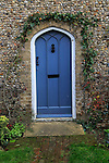 Blue door in flint home, Suffolk, England, UK