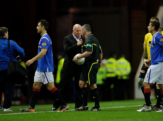 Peter Houston confronts referee Brian Winter as he walks off at the end