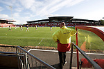 Bangor City 0 FC Honka 1, 23/07/2009. Racecourse Ground, Europa League. A steward watching as the players warm up on the pitch before Bangor City's Europa League second round second leg tie against FC Honka from Finland at Wrexham's Racecourse Ground. The match had to be staged away from City's Farrar Road ground as it did not meet UEFA's stadium standards. The Finns won 1-0 in Wales to go through 3-0 on aggregate in front of 602 spectators in the first season of the newly-introduced competition which replaced the UEFA Cup. Photo by Colin McPherson.