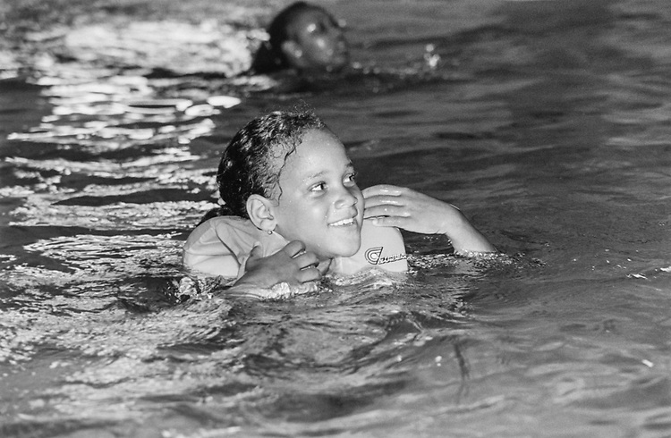 Meussa Dicus (age 7) swimming at the Greater Washington Boys and Girls Club, on July 29, 1993. (Photo by Maureen Keating/CQ Roll Call via Getty Images)