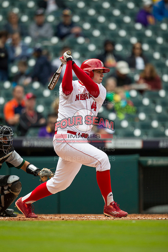 Nebraska Cornhuskers designated hitter Ben Miller (44) follows through on his swing during the NCAA baseball game against the Hawaii Rainbow Warriors on March 7, 2015 at the Houston College Classic held at Minute Maid Park in Houston, Texas. Nebraska defeated Hawaii 4-3. (Andrew Woolley/Four Seam Images)
