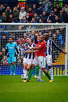 Saturday, 9 March 2013<br /> <br /> Pictured: Ashley Williams of Swansea City is challanged by James Morrison of West Bromwich Albion and Youssouf Mulumbu of West Bromwich Albion <br /> <br /> Re: Barclays Premier League West Bromich Albion v Swansea City FC  at the Hawthorns, Birmingham, West Midlands