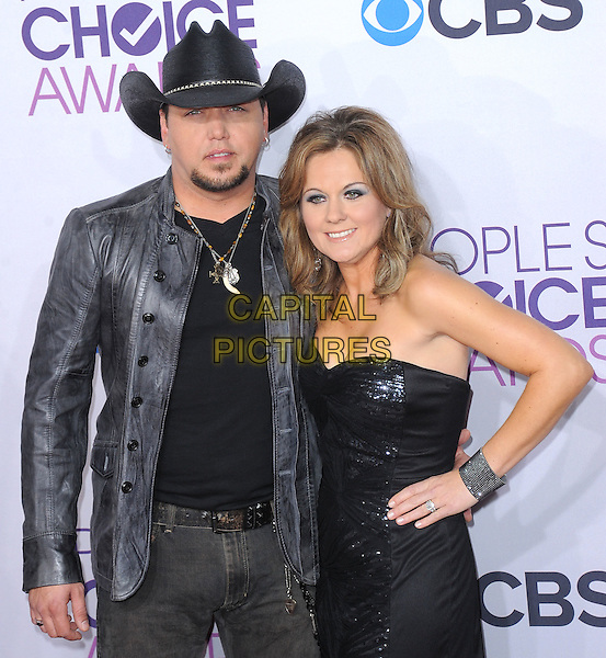 Jason Aldean and Jessica Aldean.The 2013 People's Choice Awards held at Nokia Live in Los Angeles, California 9th January 2013                                                                   .half length black strapless dress hand on hip sequins sequined top grey gray leather jacket cowboy hat.CAP/DVS.©DVS/Capital Pictures.