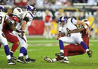 Dec 6, 2009; Glendale, AZ, USA; Arizona Cardinals defensive end (93) Calais Campbell sacks Minnesota Vikings quarterback Brett Favre in the third quarter at University of Phoenix Stadium. The Cardinals defeated the Vikings 30-17. Mandatory Credit: Mark J. Rebilas-