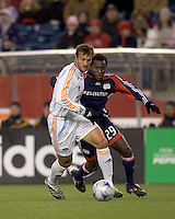 Houston Dynamo defender Eddie Robinson (2) slows down New England Revolution forward Kenny Mansally (29). The New England Revolution defeated the Houston Dynamo 3-0 in their Major League Soccer home opener at Gillette Stadium in Foxborough, Massachusetts on March 29, 2008.
