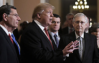 United States President Donald J. Trump talks to the press after the Republican Policy luncheon at the U.S. Capitol Building on January 9, 2019 in Washington, DC. Pictured from left to right: US Senator John Barrasso (Republican of Wyoming), the President, US Senator Todd Young (Republican of Indiana), and US Senate Majority Leader Mitch McConnell (Republican of Kentucky).<br /> Credit: Olivier Douliery / Pool via CNP /MediaPunch