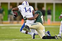 Kansas quarterback Michael Cummings (14) is brought down by Baylor nickelback Travon Blanchard (48) during NCAA football game, Saturday, November 01, 2014 in Waco, Tex. Baylor defeated Kansas 60-14. (Mo Khursheed/TFV Media via AP Images)