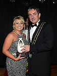 Jennifer Byrne from You're Gorgeous Hair (ygh.ie) receives the Retailer of the Year award from Mayor Richie Culhane representing sponsor Drogheda Borough Council at the Business Excellence Awards in Earth Night Club at the Westcourt Hotel. Photo:Colin Bell/pressphotos.ie