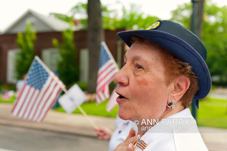 American Legion Auxiliary member marching in Merrick Memorial Day Parade on May 28, 2012, on Long Island, New York, USA. America's war heroes are honored on this National Holiday.