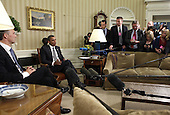 United States President Barack Obama, right, makes remarks during a photo-op with Prime Minister Jens Stoltenberg of Norway, left, in the Oval Office of the White House in Washington, DC on October 20, 2011..Credit: Yuri Gripas / Pool via CNP