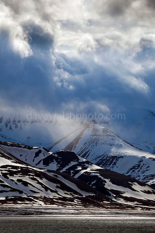 Dramatic clouds over the mountains, in Adventfjorden, Longyearbyen, Spitsbergen, in the Arctic archipelago of Svalbard