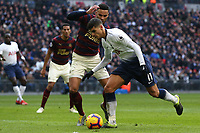 Erik Lamela of Tottenham Hotspur and Jamaal Lascelles of Newcastle United during Tottenham Hotspur vs Newcastle United, Premier League Football at Wembley Stadium on 2nd February 2019
