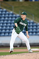 Pitcher Jesse Heikkinen (47) of the Michigan State Spartans delivers a pitch in a game against the Merrimack Warriors on Saturday, February 22, 2020, at Fluor Field at the West End in Greenville, South Carolina. Merrimack won, 7-5. (Tom Priddy/Four Seam Images)