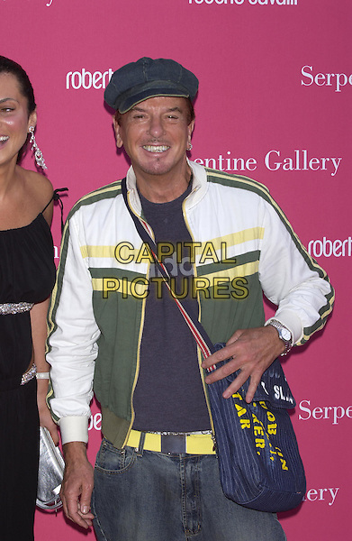 NICKY HASLAM.Arrives at the Serpentine Gallery Summer Party,.Kensington Palace Gardens,.London, 16 June 2004..half length half-length cap hat one silver earing sweaty green yellow and white sports top yellow belt blue pinstripe bag over shoulder .www.capitalpictures.com.sales@capitalpictures.com.©Capital Pictures