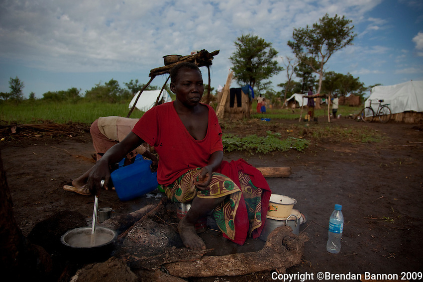 """Lomo Rama Abora , mother of 6, prepares breakfast with her children in Nyori refugee camp. Her where kidnapped by the LRA. """" They started to tie my children with rope. After they tied them they pulled them like goats into the forest."""""""