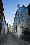 BRUSSELS - BELGIUM - 07 JANUARY 2012 -- Marolles the bohemian city part of Brussels. -- Wall-painting by Verron and Yann on Rue des Capucins. The massive court house of Brussels, Palais de Justice in the background. -- PHOTO: Juha ROININEN /  EUP-IMAGES