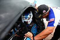 Apr 22, 2017; Baytown, TX, USA; NHRA pro stock driver Tanner Gray prays with RFC chaplain Craig Garland during qualifying for the Springnationals at Royal Purple Raceway. Mandatory Credit: Mark J. Rebilas-USA TODAY Sports