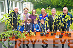 To help the local Farranfore Development group and Tidy Towns comittee the children of Farranfore National School donated plants from their school garden. <br /> Front L-R Brian O'Leary, Rachel and Eugene Deniel and Emily Kenny. <br /> Back L-R John O'Donoghue (chair of Farranfore Tidy Towns), Aine Daly (principal), Amanda Gleeson (parents association), Alacoque Daly (Farranfore Development Association), Richard Sherwood (chairman of Farranfore Development Association) and Tim O'Leary (parents association garden committee).