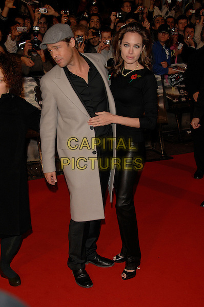 "BRAD PITT & ANGELINA JOLIE.""Beowulf"" European film premiere.Vue cinema, Leicester Square, London, England.11th November 2007.full length black leather trousers grey hat cap coat couple .CAP/PL.©Phil Loftus/Capital Pictures"