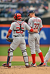 11 April 2012: Washington Nationals starting pitcher Stephen Strasburg is given some words of encouragement from catcher Jesus Flores during action against the New York Mets at Citi Field in Flushing, New York. Strasburg had the longest outing of his career, throwing 108 pitches for his first win of the season, as the Nationals shut out the Mets 4-0 to take the rubber match of their 3-game series. Mandatory Credit: Ed Wolfstein Photo