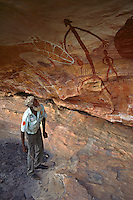 ElderTommy George Snr, Giant Horse Gallery, Rock Art Gallery, Laura Sandstone Escarpments, Laura, Cape York Peninsula, Queensland, Australia.