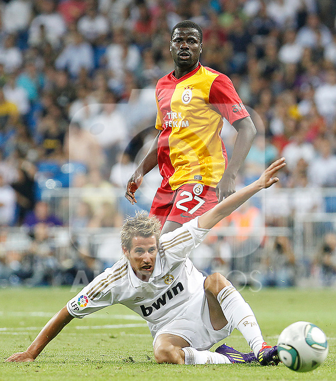 Real Madrid's Fabio Coentrao (d) and Galatasaray's Eboue during Santiago Bernabeu Trophy.August 24,2011. (ALTERPHOTOS/Acero)