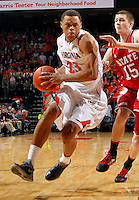 Virginia guard Justin Anderson (23) drives past North Carolina State forward Scott Wood (15) during the game Saturday in Charlottesville, VA. Virginia defeated NC State 58-55.