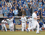 Norichika Aoki (Royals), team group,<br /> OCTOBER 15, 2014 - MLB : Norichika Aoki (23) of the Kansas City Royals celebrates with Christian Colon (24) and Raul Ibanez (18) after winning the Major League Baseball American League championship series Game 4 at Kauffman Stadium in Kansas City, Missouri, USA. <br /> (Photo by AFLO)