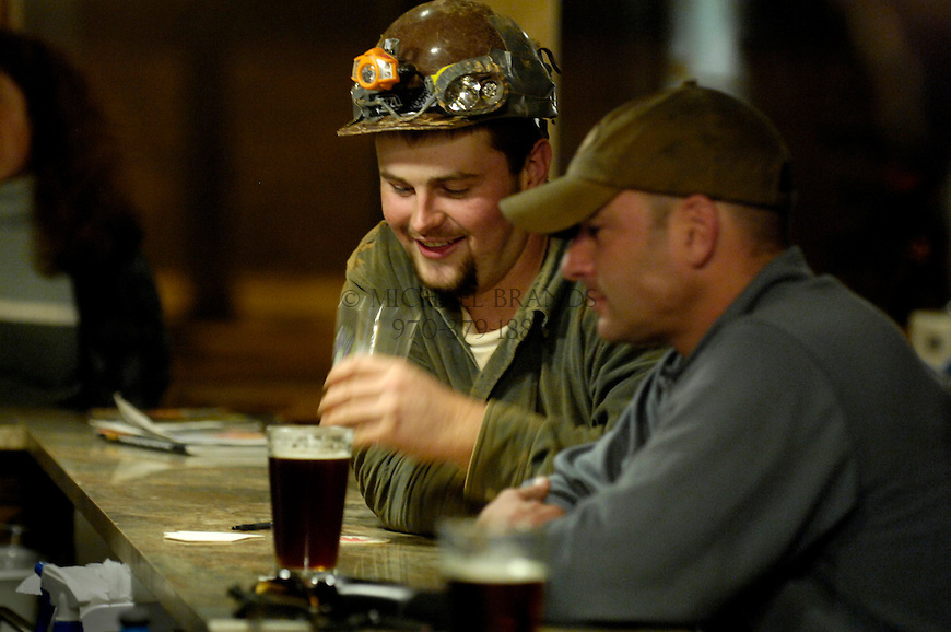 Gordi Barker, left, and Christoper Powell enjoy a drink at Kinfolks Mountain Shop. Barker is a hobbyist spelunker and decided to go out for a beer after an afternoon of caving. Kinfolks is a bar, music venue, and ourdoor gear shop. Michael Brands for The New York Times.