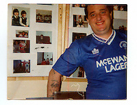 A photograph from Tommy's family albumg showing him in his cell in the maze prison. Tommy's comment about the picture: 'Me and my pictures. My daughters are my life and it was thanks to them that I was able to do my time. Knowing that in December 1997 they would be waiting on me. My marriage broke down. I don't blame her but life goes on. I have 5 beautiful daughters, 6 Grandsons & 6 Granddaughters and counting.' .