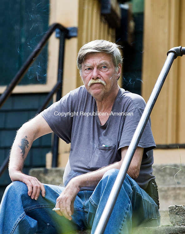 Waterbury, CT- 06 August 2015-080615CM04-  Robert Burke sits outside  his residence in Waterbury on Thursday, August 06, 2015. Burke was released from prison early after serving time for the killing of a 16-year-old girl.  Christopher Massa Republican-American