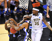 The Bulldogs' Chris Stephenson (4) tries to control the loose ball. Pittsburgh defeated UNC-Asheville 74-51 during the NCAA tournament at the Verizon Center in Washington, D.C. on Thursday, March 17, 2011. Alan P. Santos/DC Sports Box