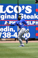 Dunedin Blue Jays outfielder Dwight Smith Jr. (25) tracks down a fly ball during a game against the Clearwater Threshers on April 6, 2014 at Bright House Field in Clearwater, Florida.  Dunedin defeated Clearwater 5-2.  (Mike Janes/Four Seam Images)