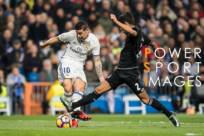 """James Rodriguez of Real Madrid competes for the ball with Juan Francisco Moreno Fuertes """"Juanfran"""" of RC Deportivo La Coruna during the La Liga match between Real Madrid and RC Deportivo La Coruna at the Santiago Bernabeu Stadium on 10 December 2016 in Madrid, Spain. Photo by Diego Gonzalez Souto / Power Sport Images"""