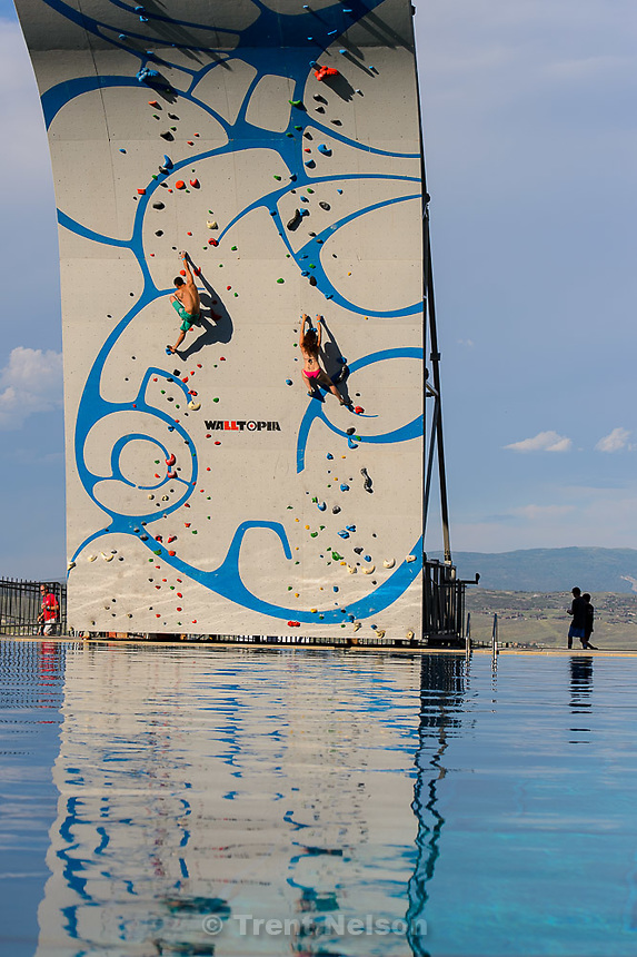 Trent Nelson  |  The Salt Lake Tribune<br /> Climbers on a giant climbing wall at the grand opening of the expanded Spence Eccles Olympic Freestyle Pool at Utah Olympic Park, Saturday June 27, 2015. The Eccles family donated $1 million to kick off a $3 million fundraising campaign to expand the pool and replace four old wooden jumps with seven metal jumps that have different lift-off angles suited to the various Winter Olympic sports disciplines.