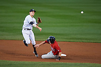 Empire State Yankees second baseman Corban Joseph #1 attempts to turn a double play as Jeremy Hazelbaker #34 slides in during game four of a best of five playoff series against the Pawtucket Red Sox at Frontier Field on September 8, 2012 in Rochester, New York.  Pawtucket defeated Empire State 7-1 to advance to the International League Finals.  (Mike Janes/Four Seam Images)