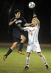 (Worcester Ma 111613)  Belchertown 6, Oliver Hopkins,  takes it on the chin from Medway 9, Justin Kaplin going up for a header in the first half,  during the MIAA Division Three Boys Soccer Final between Belchertown High and Medway High, Saturday night at Foley Field in Worcester. (Jim Michaud Photo) For Sunday