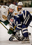 10 February 2017: University of Vermont Catamount Forward Derek Lodermeier, a Freshman from Brooklyn Center, MN, works a face off against University of New Hampshire Wildcat Forward Michael McNicholas, a Junior from Manhattan Beach, CA, in the first period at Gutterson Fieldhouse in Burlington, Vermont. The Catamounts fell to the Wildcats 4-2 in the first game of their 2-game Hockey East Series. Mandatory Credit: Ed Wolfstein Photo *** RAW (NEF) Image File Available ***