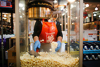New York, USA. 19 August 2014. A home depot worker prepares pop corn inside of a store while Home Depot company prepares its Quarterly results at the Stock Exchange in New York.  Eduardo Muñoz Alvarez/VIEWpress