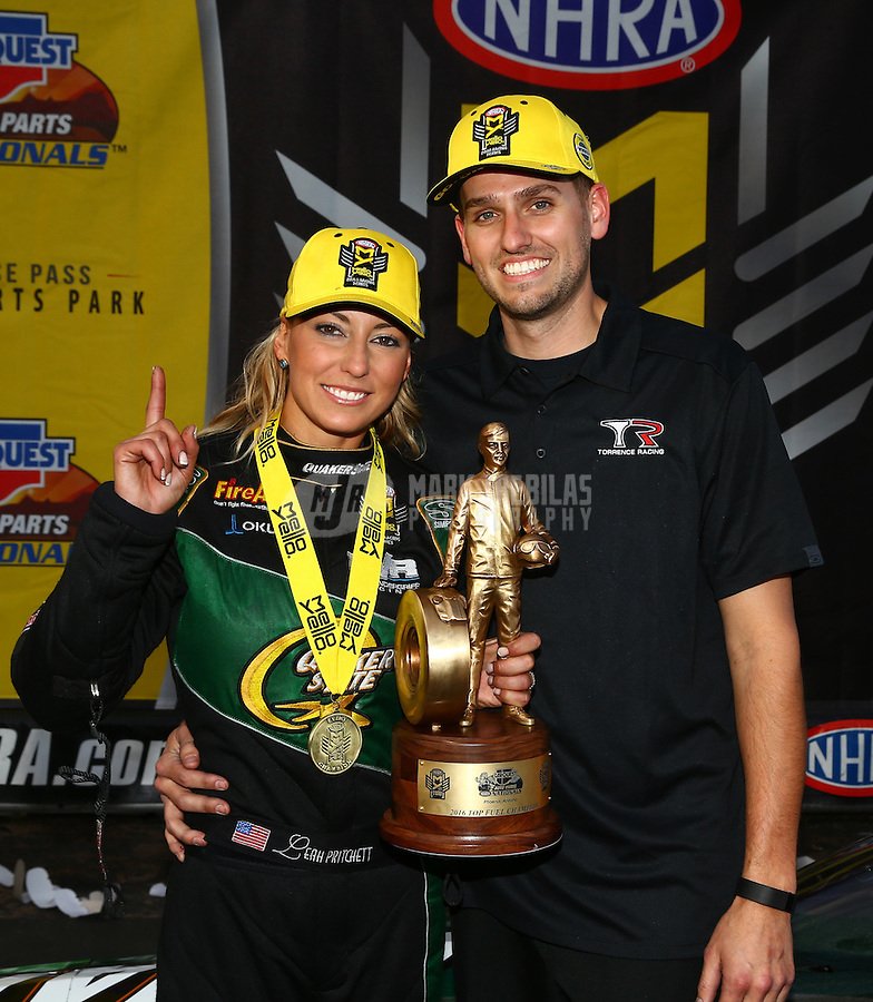 Feb 28, 2016; Chandler, AZ, USA; NHRA top fuel driver Leah Pritchett celebrates with husband Gary Pritchett after winning the Carquest Nationals at Wild Horse Pass Motorsports Park. Mandatory Credit: Mark J. Rebilas-USA TODAY Sports