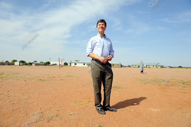 Jeffrey Sachs stood in the grounds of the school in the village of Dertu in north-east Kenya, which is home to a largely nomadic group of Somali Kenyans, after laying the first stone for a new computer room at the local school. The village is one of the villages of the Millennium project, an attempt to create prototype villages across Africa that will help raise impoverished villages by systemising health, education and the local economy. January 10, 2010