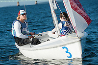 Sean Beaulieu,'18,  left, Captain, and Jen Ryan,'19, crew, work together as they practice with other members of the Salve Regina Sailing Team in the Newport Harbor.