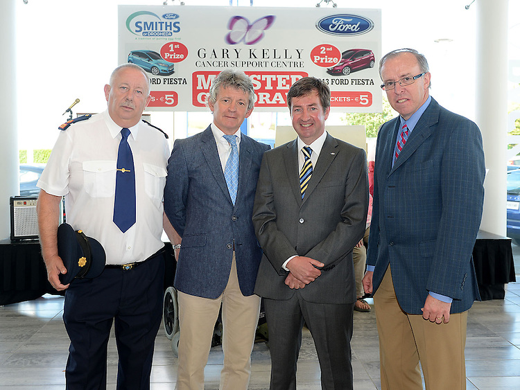 Garda Superintendent Gerry Smith, Paddy Dwyer Gary Kelly Centre, Nicky Smith MD Smith's garage, Ford CEO Eddie Murphy at the Monster car draw in Smith's garage in aid of the Gary Kelly Cancer Support Centre. Photo:Colin Bell/pressphotos.ie