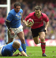 27/03/2004  -  RBS Six Nations Championship 2004 Wales v Italy.Welsh centre Iestyn harris breaks through the Italian defenders.    [Mandatory Credit, Peter Spurier/ Intersport Images].
